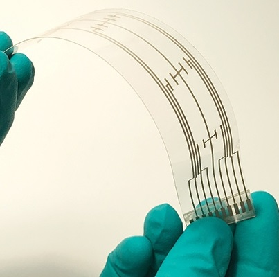 A New Manufacturing Approach for Flexible Hybrid Electronics